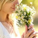shutterstock_115403533smellingflowers1